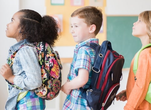 Kids wearing backpack through The Essendant Charitable Foundation